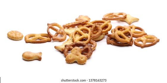 Salty cracker and pretzel snacks, party mix isolated on white background