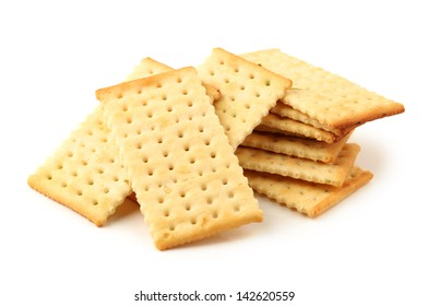 Salty crackers in square shape on white background