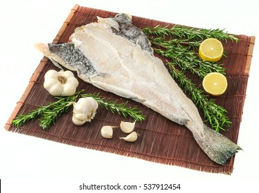 Salty dry cod  fish with garlic and rosemary.