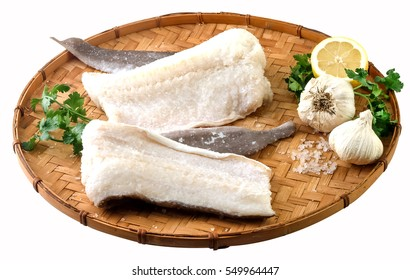 Salty dry fish with garlic,lemon and parsley.