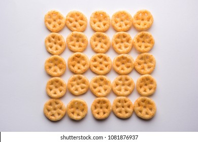 Salty fried wheel snack arranged over white background creating pattern