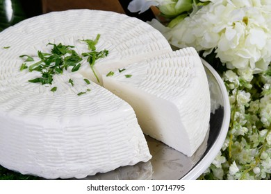 Salty hard cheese, Greek style, on a table
