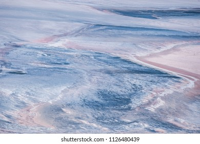 Salty lake with patterns similar to the surface of Mars, Saturn, Earth or other planets from outer space