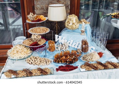 The salty nuts and fishes standing on the buffet table