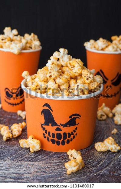 Salty Popcorn for Halloween with scary pumpkin faces