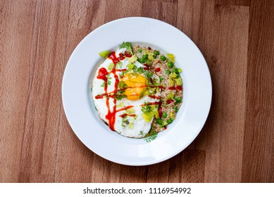 Salty porridge with egg and herbs