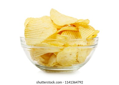 salty potato chips in glass bowl isolated on white