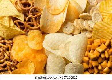 Salty snacks. Pretzels, chips, crackers - Shutterstock ID 637166818