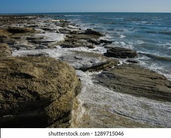 The salty waves of the bay Kara-Bogaz-Gol, washed coast. The Karakum, Turkmenistan.