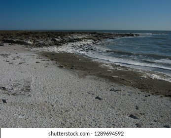 The salty waves of the Karabogaz-gol bay are washed by the coast. Karakum, Turkmenistan.