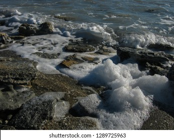 Salty waves throw foam on the coast of Kara-Bogaz-Gol. The Karakum, Turkmenistan.