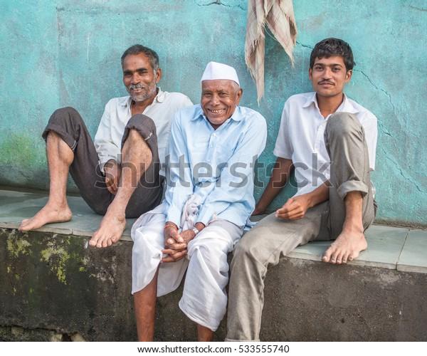 SALUNKWADI, INDIA - August 12, 2016: Rural people daily lifestyle, Indian rural men taking rest in rural village Salunkwadi, Ambajogai, Beed, Maharashtra, India, Southeast Asia.