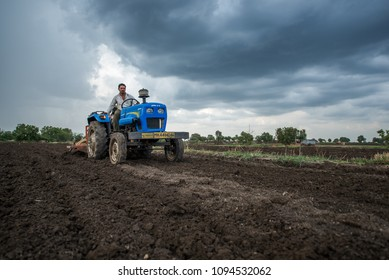 SALUNKWADI, INDIA - June 17, 2017: Farmer sowing seeds with automatic seed cum fertilizer drill machine in rural village Salunkwadi, Ambajogai, Beed, Maharashtra, India, Southeast Asia