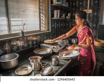 SALUNKWADI, INDIA - June 20, 2017: Lady cooking in the kitchen rural village Salunkwadi, Ambajogai, Beed, Maharashtra, India, Southeast Asia