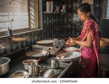 SALUNKWADI, INDIA - June 20, 2017: Lady cooking in the kitchen rural village Salunkwadi, Ambajogai, Beed, Maharashtra, India, Southeast Asia