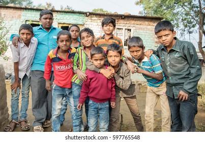 SALUNKWADI, INDIA - November 14, 2016: Indian rural children group, peoples daily lifestyle in rural village Salunkwadi, Ambajogai, Beed, Maharashtra, India, South East Asia.
