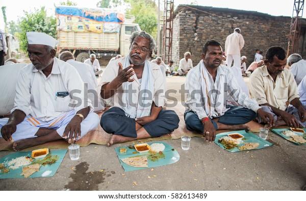 SALUNKWADI, INDIA â?? November 15, 2016: Community lunch in rural village Salunkwadi, Ambajogai, Beed, Maharashtra, India, South East Asia.