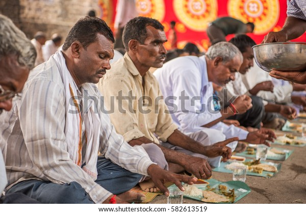 SALUNKWADI, INDIA â?? November 15, 2016: Community lunch in rural village Salunkwadi, Ambajogai, Beed, Maharashtra, India, South East Asia.