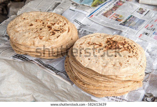 SALUNKWADI, INDIA â?? November 15, 2016: Indian bread called Chapati made on community lunch in rural village Salunkwadi, Ambajogai, Beed, Maharashtra, India, South East Asia.
