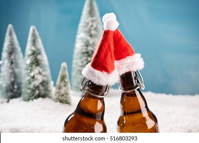 Salut! Two beer bottles saying cheers. Fresh draught lager beer cooled well on winter background.