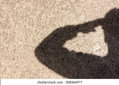 Salute shadow on the grunge cement background with copy space