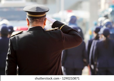 Saluting Japanese police officers in a row, ceremony