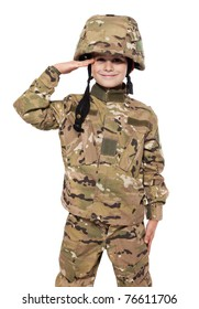 Saluting soldier. Young boy dressed like a soldier isolated on white
