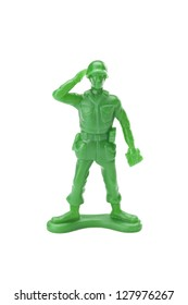 Saluting toy soldier isolated in a white background
