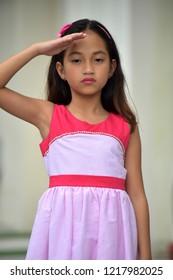 Saluting Youthful Asian Girl Child