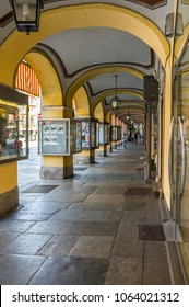 Saluzzo, Piedmont, Italy - June 16, 2012: Under the arcades in the old town.
