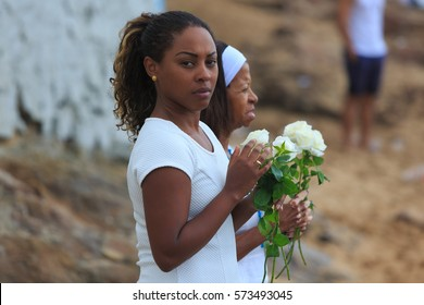 SALVADOR, BAHIA, BRAZIL - February 02, 2017 - Iemanja party with mother and daughter  woman making an offering to the Queen of the Sea