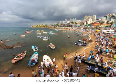 SALVADOR, BAHIA, BRAZIL - February 02, 2017:  Iemanja party with boats and people on the beach making an offering to the Queen of the Sea,