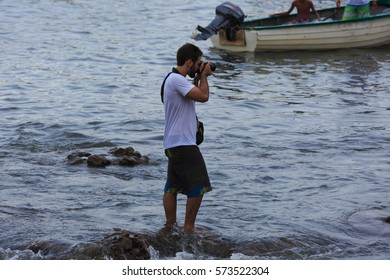 SALVADOR, BAHIA, BRAZIL - February 02, 2017:  Iemanja party with man photographing the festival of the Queen of the Sea
