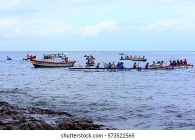 SALVADOR, BAHIA, BRAZIL - February 02, 2017:  Iemanja party with people on a boat  making an offering to the Queen of the Sea