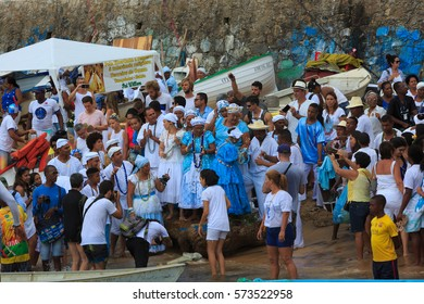 SALVADOR, BAHIA, BRAZIL - February 02, 2017:  Iemanja party with people singing and dancing by the ocean dressed in blue and white , celebrating Queen of the Sea