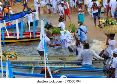 SALVADOR, BAHIA, BRAZIL - February 02, 2017:  Iemanja party with people putting flower arrangements into boats to take to sea , making an offering to the Queen of the Sea
