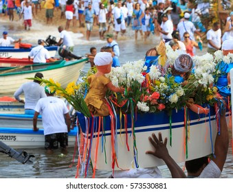 SALVADOR, BAHIA, BRAZIL - February 02, 2017:  Iemanja party with men carrying a boat of flowers, making an offering to the Queen of the Sea