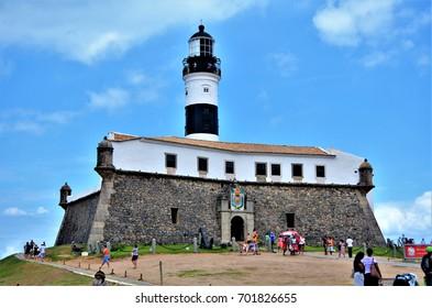 Salvador, Bahia, Brazil February 27, 2013: The Barra Lighthouse or Santo Antônio Lighthouse is part of the Santo Antônio da Barra Fort complex., which also houses the Nautical Museum.