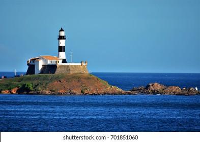 Salvador, Bahia, Brazil - February 27, 2013 - The Farol da Barra is located at Ponta de Santo Antônio, in Salvador. The lighthouse is built inside the Fort of Santo Antônio da Barra.