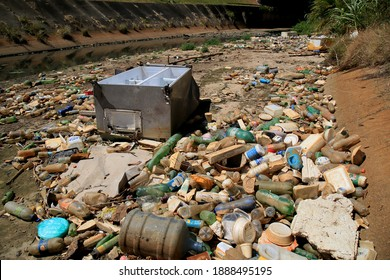salvador, bahia, brazil - january 6, 2021: garbage and pet bottles are seen accumulated in a canal on the Rio Camurugipe, in the Pituba neighborhood, in the city of Salvador.