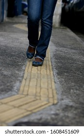 salvador, bahia / brazil - july 24, 2014: Sidewalk with tactile floor used for guidance for the visually impaired is seen in the Pituba neighborhood of Salvador.