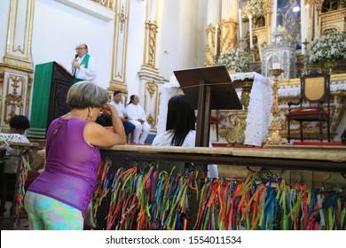 SALVADOR, BAHIA / BRAZIL - November 8, 2019: Faithful are seen during mass celebration at Bonfim Church in Salvador (BA) (SHUTTERSTOCK / Joa Souza).