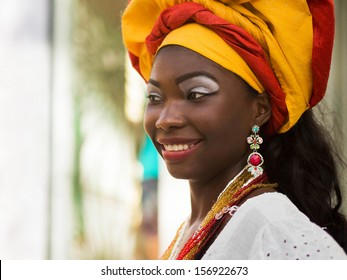 Salvador, Bahia, Brazil - October 13: Brazilian woman of African descent, smiling, wearing traditional attire in the old colonial district of Pelourinho in Salvador, Bahia, Brazil.