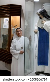 salvador, bahia / brazil - october 3, 2019: Religious is seen next to sculpture of Santa Dulce of the Poor at the memorial honoring the nun in the city of Salvador.