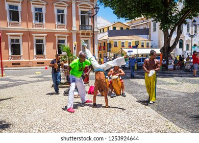 Salvador, Brazil, 12/14/2012, Capoeira on the streets. Capoeira is a Brazilian national martial art, combining elements of dance, acrobatics, games, and accompanied by Brazilian national music.