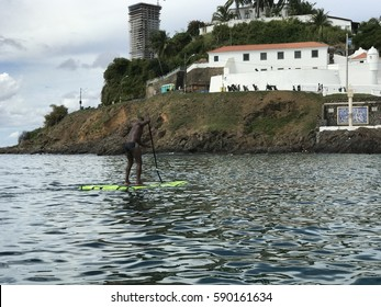 SALVADOR, BRAZIL - FEB 23, 2017: Man in a Stand Up Board Paddling , Porto da Barra Beach.