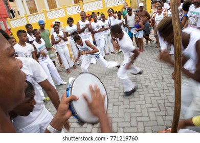 SALVADOR, BRAZIL - FEBRUARY 02, 2016: Brazilian capoeira group performs for a crowd at an outdoor festival in the Rio Vermelho neighborhood. Motion Blur.