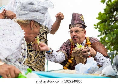 Salvador, Brazil. February 18, 2018. Brazil. Holy Father feeding a devotee during the procession of Iemanja.