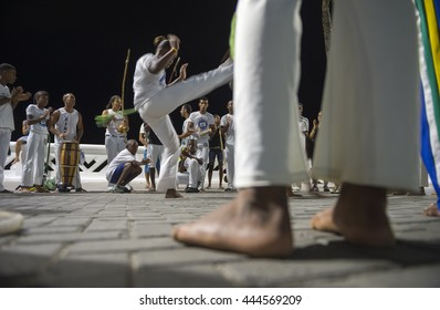 SALVADOR, BRAZIL - FEBRUARY 20, 2016: Brazilian capoeira group performs at night on the seafront promenade in the gentrifying Barra neighborhood.