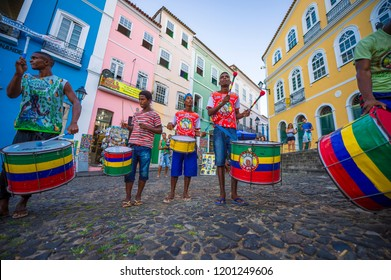 SALVADOR, BRAZIL - FEBRUARY, 2018: A group of young Brazilian drummers make their way around the colorful buildings of the historic tourist neighborhood of Pelourinho.